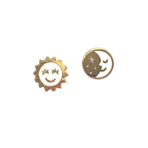 By Rather Keen. Sun and Moon Stud Earrings. ♫ But when the sun goes down. And the moon comes through. To the monotone of the evening's drone. I'm all alone with you ♫—Ella Fitzgerald. 22k gold plated stud earrings. Nickel-Free! Measures 11mm wide. Also available in store at FOLD Gallery DTLA.