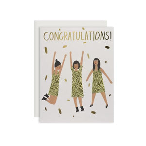 By Red Cap Cards. Three Women Congrats Foil Card. Foil. 100lb Heavyweight Cardstock. Illustrated by Kate Pugsley. Measures 4.25 x 5.5 inches. Also available in store at FOLD Gallery DTLA.