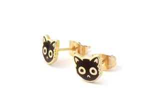 By SHOAL. Now you can wear grouchy cats on your ears whenever you want! Black Enamel Cat Face Stud Earrings. Metal composition: 22k gold-plated brass, nickel-free. 8mm (5/16 inch) width. 22k gold-plated earring backs. Packaged in a cute keepsake box, perfect for gift-giving!