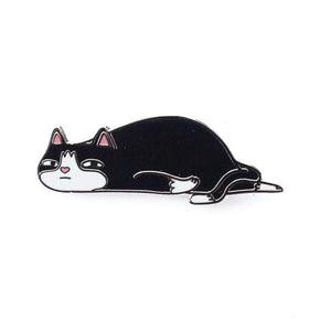 By Shoal. Hard enamel Ennui Cat Pin with gunmetal finish. Double pin posts with rubber clutch backs. Measures 1.25 inches wide.