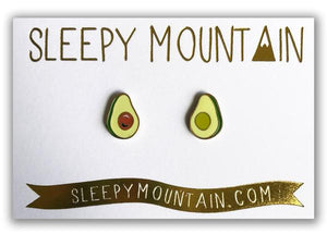 By Sleepy Mountain. Enamel Avocado Earrings are 22k gold plated stainless steel. Includes butterfly backings as well as nylon stops. Please note that due to everyone's monitor displaying differently, the colors you see may vary. Measures 0.5 inches. FOLD Gallery Dtla.