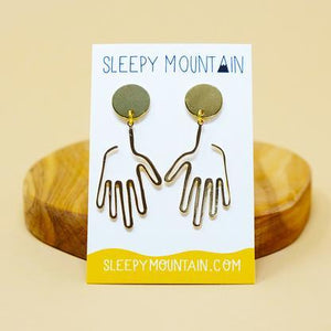 By Sleepy Mountain. Hand Dangle Earrings: Light weight and comfortable. 14k gold plated brass. Care: Store away from moisture and other jewelry to avoid scratching or tarnish. Wipe clean with microfiber cloth. Measures: Overall size 1.75 inches Hand size 1.3 inches.