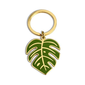 By Sleepy Mountain. Monstera Leaf Gold Keychain. The leaf measures 1.5 inches tall. Also available in store at FOLD Gallery DTLA.