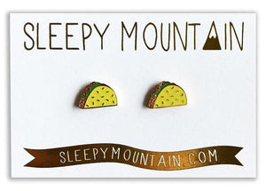 By Sleepy Mountain. Enamel color Taco Earrings are 22k gold plated stainless steel. Includes butterfly backings as well as nylon stops. Measures 0.5 inches. Also available in store at FOLD Gallery DTLA.