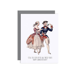 By Sylvan Gate Design. Anniversary Couple Glitter Card features natural white 100% PCW paper card and has subtle glitter accents and is made entirely by hand in California. Card is blank inside and comes in a signature grey, square flap envelope.