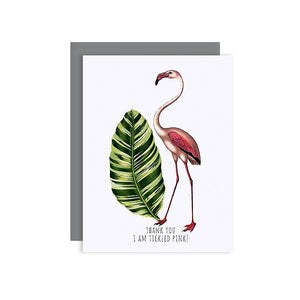 By Sylvan Gate Design. This natural white Flamingo Thank You Glitter Card has subtle glitter accents and is made entirely by hand in California. Card is blank inside and comes in a signature grey, square flap envelope. Measures 4.25 x 5.5 inches.
