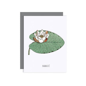 By Sylvan Gate Design. Namaste Lily Glitter Card: This natural white card has subtle glitter accents and is made entirely by hand in California. Card is blank inside and comes in a signature grey, square flap envelope. Measures 4.25 x 5.5 inches. Also available in store at FOLD Gallery DTLA.