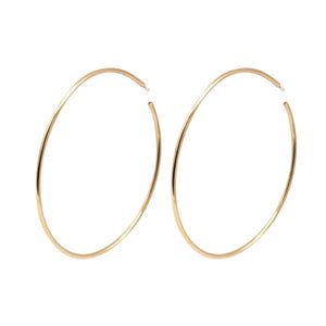 By TUMBLE. These Big Hoop Gold Filled Earrings are the perfect way to make a statement without weighing your ears down. All posts are sterling silver. Measures 2.5 inches. FOLD Gallery Dtla.