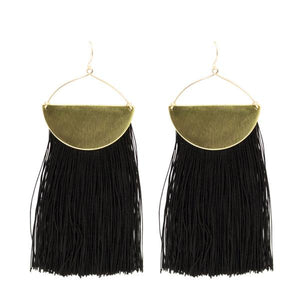 By TUMBLE. On The Move Pure Silk Tassel Earrings in Jet Black. Pure jet black silk fringe earrings with brass half circle accents. Measures 1.5 x 4 inches. Also available in store at FOLD Gallery DTLA.