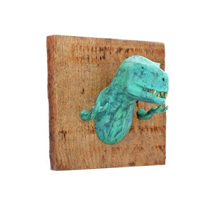 By The Creature Den. This Green T-Rex Wall Hook is cast in Urethane, a strong yet lightweight plastic material. This makes it strong enough to be used functionally. The Creatures are mounted on US reclaimed wood and have two (2) key hole hangers on the back for attaching to a wall. Measures 6 x 6 x 6 inches.