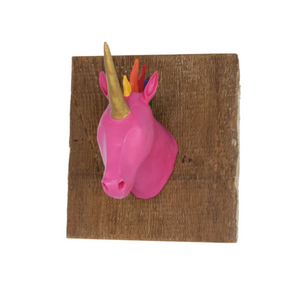 By The Creature Den. Pink Rainbow Hair Unicorn Wall Hook. This creature is cast in Urethane, a strong yet lightweight plastic material. This makes it strong enough to be used functionally. The Creatures are mounted on US reclaimed wood and have two (2) key hole hangers on the back for attaching to a wall. 6x6x6 inches. Also available in store at FOLD Gallery DTLA.