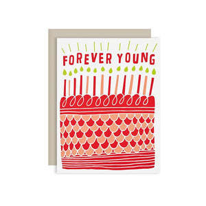 by The Good Twin. Forever Young Birthday Card. Three color screen print on French Paper. Packed in a cello sleeve with corresponding envelope. Envelope color may vary. Blank inside. Please note that due to everyone's monitor displaying differently, the colors you see may vary. Measures 4.25 x 5.5 inches folded.