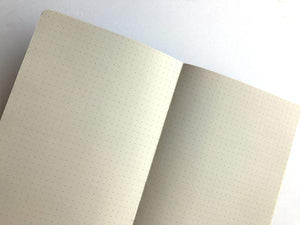 By The Mincing Mockingbird & The Frantic Meerkat. Jittery Scribblings of an Overly Caffeinated Introvert Journal: 120 dotted grid pages of 120 gsm creamy off-white paper that takes ink beautifully. Binding lies flat when open. Measures 5 inch wide x 7 inch tall. Also available in store at FOLD Gallery DTLA.