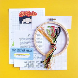 By The Stranded Stitch. Stitch some art appreciation with the Frida DIY Cross Stitch Kit. Kit Includes: Basic cross stitching instructions. Counted cross stitch pattern. DMC embroidery floss and color chart. 14 count white aida cloth. 5 inch Embroidery hoop. Needle. FOLD Gallery Dtla.