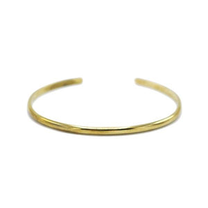 By TUMBLE. Listing is for 1 Full Round Hammered Cuff Bracelet. This cuff is hammered by hand in bronze, and heavy plated in 24k gold. You do have some wiggle room to make it tighter or looser depending on your needs. Measures approx. 2.5 x 2 inches.