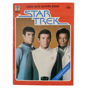 "Vintage 1970s Star Trek Activity Book ""A Launch into Fun""  This activity book contains both activity and coloring pages!  Cover depicts Kirk, Spock, and McCoy.  Measures 11 x 8 inches."