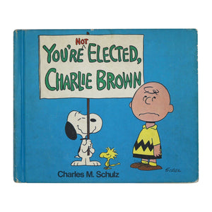 "Vintage 1973 ""You're Not Elected Charlie Brown""  Charlie Brown runs for student body president in this classic picture book.  Measures: 7.5 x 9 inches.  Condition: Pages still bound together, but no longer attached to binding, may be missing final page(s)."