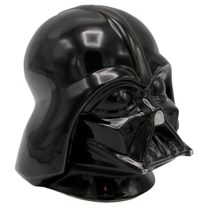 Vintage 1977 Twentieth Century Fox Film Corporation Darth Vader Piggy Bank  Ceramic Darth Vader helmet piggy bank released by Twentieth Century Fox. The coin slot is in the top of the helmet, and the piggy bank opens at the bottom.  Measures 6.25 x 6.25 x 7 inches.  Condition: Excellent condition.
