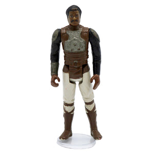 Vintage 1982 Lando Calrissian Skiff Guard Figurine  Vintage Lando Calrissian figurine, missing weapon. It has moveable legs and arms!  Measures 3.75 x 1.5 x .75 inches.  Condition: Good condition, paint is worn and there is some staining on bottom half. Missing weapon.