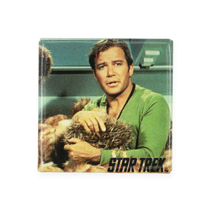 "Vintage James T. Kirk Pinback Button  Add a little flair to your jacket, backpack or tote with this Vintage James T. Kirk Pinback Button! This button depicts Captain Kirk holding a tribble from the episode ""Trouble with tribbles"".  Measures 1.5 x 1.5 inches."