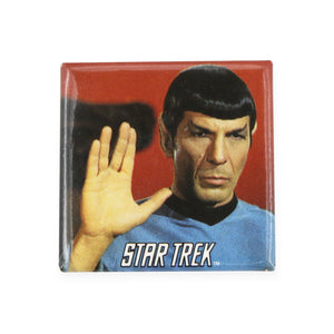 "Vintage Live Long and Prosper Pinback Button  Add a little flair to your jacket, backpack or tote with this Vintage Live Long and Prosper Pinback Button! This button depicts Spock making the Vulcan hand gesture for ""live long and prosper"".  Measures 1.5 x 1.5 inches."