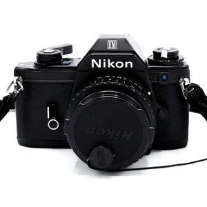 Vintage Black Body Nikon EM with Series E 1:1.8 50mm Lens, Case, Flash & Strap  Camera is in working condition.  Camera measures 3.75 x 6.5 x 6.25 inches  Please note that due to everyone's monitor displaying differently, the colors you see may vary.