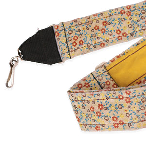 "Vintage Flower Camera Strap: This is a beautifully made vintage camera strap, produced circa 1970s. This soft strap is embroidered with a retro design in flowers of red, blue & yellow; and is reinforced with a sturdy, comfy suede backing. It features sturdy metal hardware and sturdy metal clips which attach easily to your camera. Adjustable up to 45""."