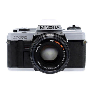 Vintage Minolta X-370 35mm Film Camera with MD Rokkor-X 50mm 1:1.7 Lens Camera is in working condition. Camera measures 3.5 x 5.5 x 3.5 inches Please note that due to everyone's monitor displaying differently, the colors you see may vary.