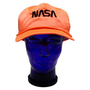 Vintage satin neon orange NASA hat with black lettering and adjustable snap back. Sweat band is yellowed at the front of the hat, only minor discoloration on the sides.  Measures 4.5 x 9.5 x 9.75 inches  Please note that due to everyone's monitor displaying differently, the colors you see may vary.