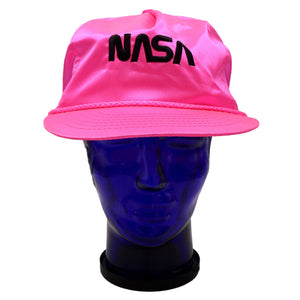 Vintage satin neon pink NASA hat with black lettering and adjustable snap back. Moderate discoloration of sweat band. Measures 4.75 x 9 x 10.25 inches. Please note that due to everyone's monitor displaying differently, the colors you see may vary.