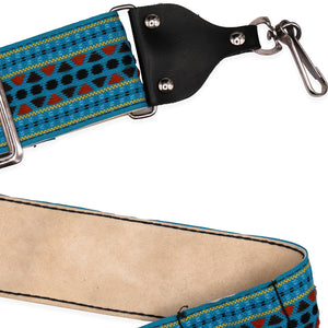 "Vintage Turquoise Camera Strap: This is a beautifully made vintage camera strap, produced circa 1970s. Soft strap is embroidered with a retro design in turquoise, red, navy, & yellow; reinforced with a sturdy, comfy suede backing. Sturdy metal hardware and sturdy metal clips. Adjustable up to 45"" with 2"" wide strap."