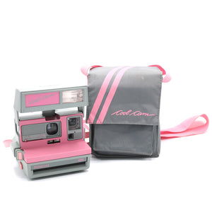 Vintage Polaroid Pink Cool Cam 600 Film Camera with Case. Camera is in working condition. Camera closed measures 4.5 inch width x 3.75 inch height x 6 inch depth. Also available in store at FOLD Gallery DTLA.