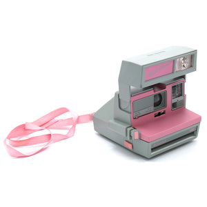 Vintage Polaroid Pink Cool Cam 600 Film Camera with Case. Camera is in working condition. Camera closed measures 4.5 inch width x 3.75 inch height x 6 inch depth. FOLD Gallery DTLA.