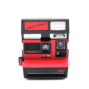 Vintage Polaroid Red Cool Cam 600 Film Camera and Manual. Camera is in working condition. Camera closed measures 5 inch width x 4 inch height x 6 inch depth. FOLD Gallery Dtla