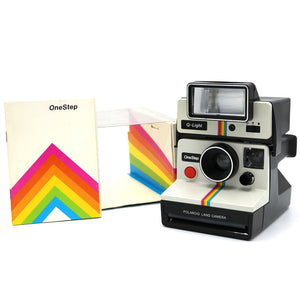Vintage Polaroid Rainbow One Step Camera with Q Light and Original Box. Camera is in working condition. Camera without Q-Light measures 4 inch width x 4 inch height x 5.5 inch depth. FOLD Gallery Dtla.