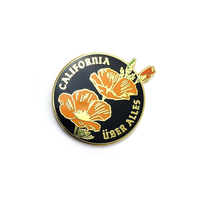 By World Famous Original. Gold finish hard enamel California Uber Alles Pin. Show your California Love with a Dead Kennedys reference thrown in for good measure! Measures 1.2 inches. Also available in store at FOLD Gallery in DTLA.