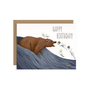 By Yeppie Paper. Grizzly Bear Cupcakes Birthday Card: Professionally printed in full color in Los Angeles. FSC-certified, recycled 110 lb. cover weight, soft white paper. Matching recycled kraft envelope. Blank inside with single color logo on back. Folded card measures 4.25 x 5.5 inches.