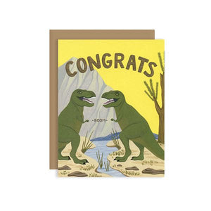 By Yeppie Paper. T-Rex Fist Bump Congrats Card. Professionally printed in full color in Los Angeles. FSC-certified, recycled 110 lb. cover weight, soft white paper. Matching recycled kraft envelope. Blank inside with single color logo on back. Card and envelope packaged in a clear cello sleeve. Measures 4.25 x 5.5. Also available in store at FOLD Gallery DTLA.