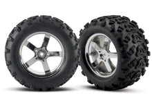 Traxxas Part No: 4973R Tires & wheels, assembled, glued Hurricane chrome wheels