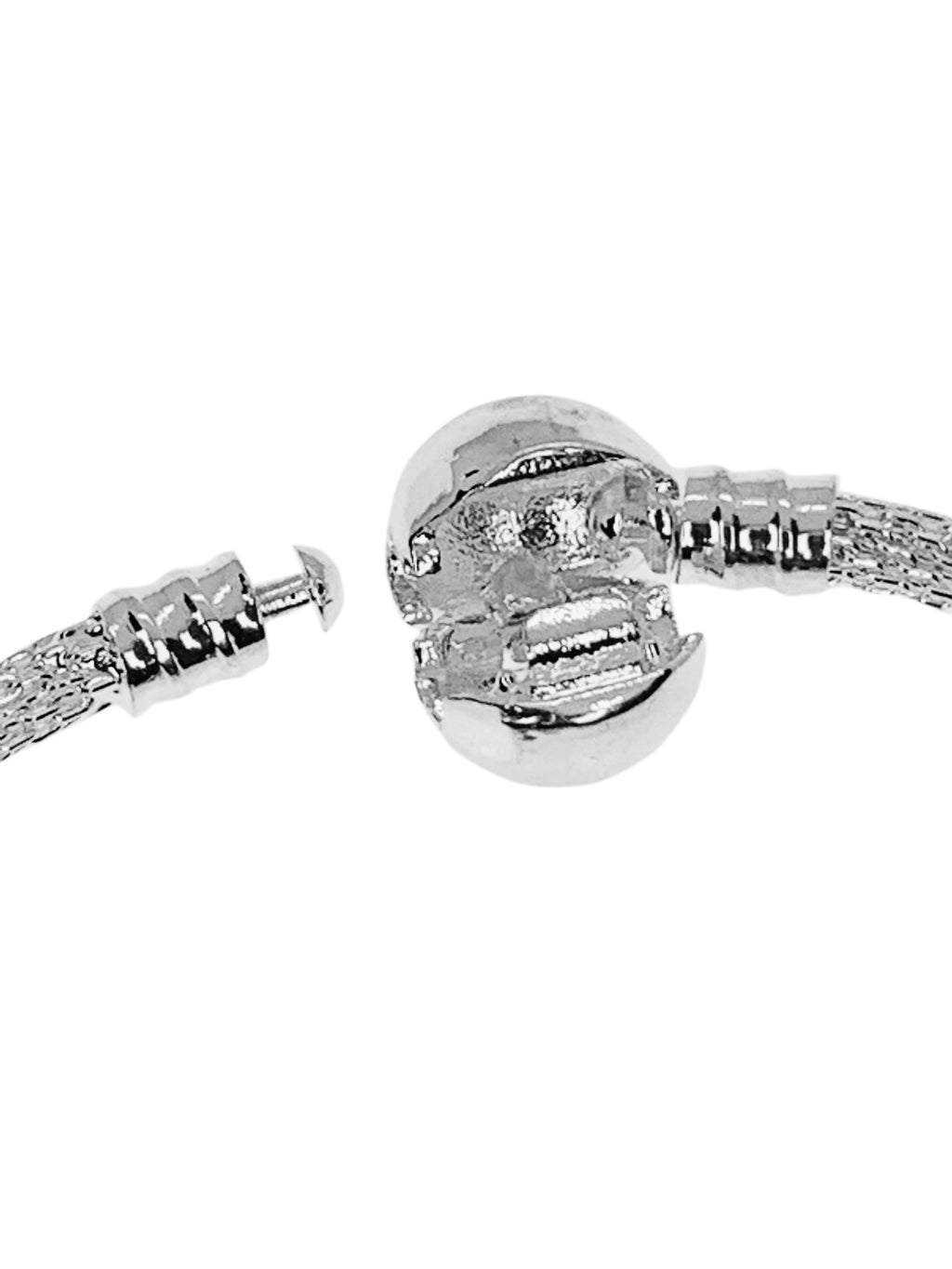 Bling Bangle Clasp is easy to open. Just slide your nail in and lever it open. When closing, simply line up the tiny mushroom head until it sits into the little cradle of the Ball Clasp and then snap it closed.