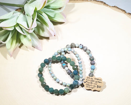 Blue ocean and moss green hued Agate mixed gemstone bracelet with luster beads and a sterling silver accent bead.