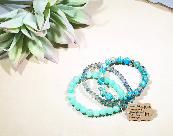 Teal Quartzite and mixed green hued stone and luster beads with a sterling silver accent bead set.