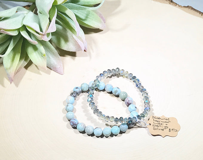 A stunning natural Larimar gemstone and luster bead bracelet set with a sterling silver accent bead.
