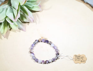 A stunning flower Amethyst faceted bracelet with sterling silver accent bead.