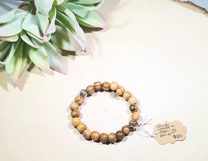 Olive wood and sterling silver beaded bracelet.
