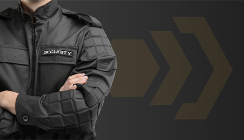 security guard with arms folded