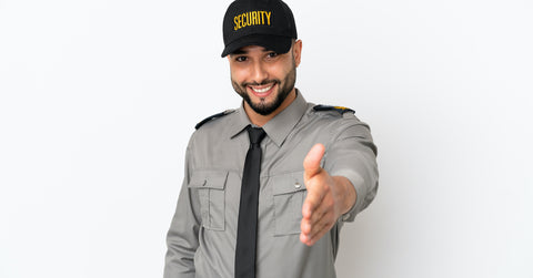 Security guard reaching arm out to shake hands