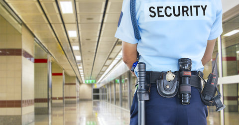 Security guard with belt surveilling a hallway