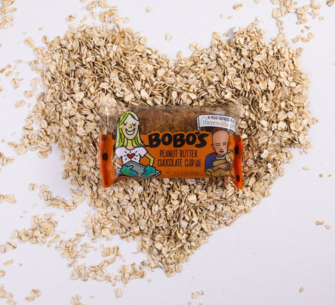 A Bobo's Oat Bar on a bed of oats shaped like a heart