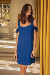 woman in blue cold shoulder dress